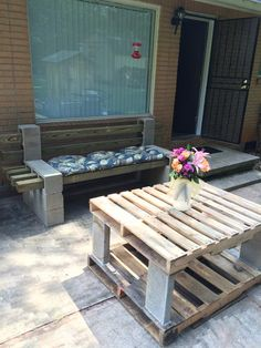easy pallet table. use cement glue to fix cinder block and pallet together