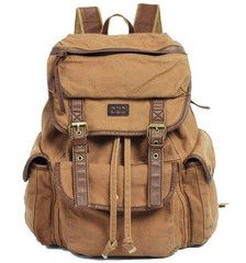 Premium quality Brown Canvas Travel Rucksack Backpack for women and men. * Double shoulder straps with short handle.  * Rucksack style.  *
