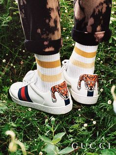 Presenting gifts from the Gucci Garden. The tiger embroidered Gucci Ace sneakers by Alessandro Michele.