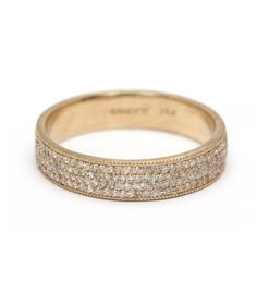"""This is divine luxury! We like to call this stunning 14K gold band """"The Glitterati"""" for obvious reasons. Featuring four rows of precisely-set pave diamonds (0.69ctw), this beautiful band provides 360 degrees of non-stop high wattage sparkle. Band measures 4mm and is finished with delicate milgrain edges. Wear it with your favorite stacking rings, engagement ring or as a stand alone statement piece.*Sunglasses optional*rings sold seperately"""