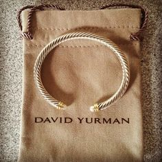 Yurman. My mom always had one of these when i was growing up. Except hers had diamonds on the ends. Lucky. :[