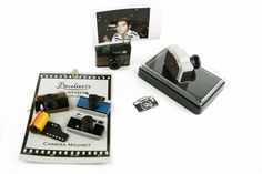 Great gift for many of my friends. Kit includes a camera stamp + ink pad, set of magnets and a photo stand. $25