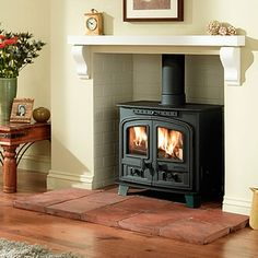 Wood Stove on interesting brick hearth, brick chamber & timber shelf Wood Burner Fireplace, Fireplace Mantle, Wood Stove Wall, Fireplace Ideas, Foyers, White Mantel, Multi Fuel Stove, Log Burner, My Living Room