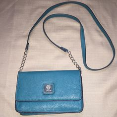 Jessica Simpson Cross body Teal color cross body handbag. It's about 8 inches wide, 5 inches high and the handle is about 24 inches long. It has several places for credit cards and pockets. Very cute! Jessica Simpson Bags Crossbody Bags