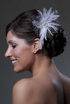 Wedding hair with feather hairpiece