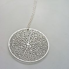 reticulate - stainless steel pendant, intricate circular leaf network nature science organic jewelry. $50.00, via etsy.