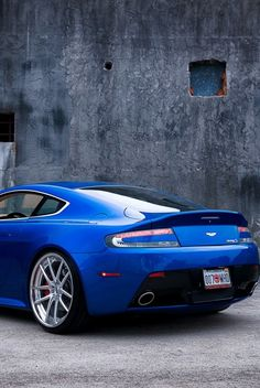 The Aston Martin is one of the most elegant grand tourer supercars available. Available in a couple or convertible The Aston Martin has it all. Aston Martin Rapide, Aston Martin Cars, Aston Martin Vanquish, Aston Martin Vantage, My Dream Car, Dream Cars, Aston Martin Sports Car, Ford Classic Cars, Sport Cars