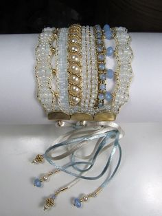 A lacy corset style cuff woven with cup chain on a Loom. by Erin Simonetti. This artist does exquisite work!!!