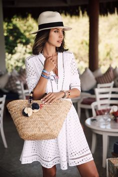 hat with white cut out dress