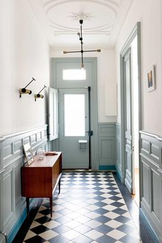 Love the accent paint on baseboard to offset wainscoting from patterned floor