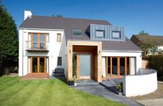 Angela and Alastair Geddes have opened up the interior of their property by extending and adding stunning design features for a contemporary finish Dormer House, Dormer Windows, House Makeovers, House Cladding, Garden Architecture, Exterior Doors, Detached House, Home Builders, Building A House