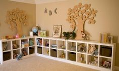 DIY shelves. This could go all along the long wall in the playroom.  Maybe put Lego flats on the top.