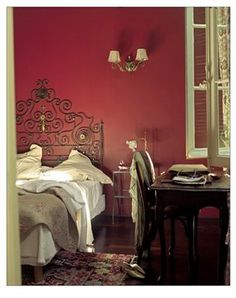 Love red walls and dark wood furniture.