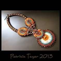 This stunning one-of-a-kind wearable art piece was created around 3 lovely vintage German glass marquise-cut brown cabochons and a beautiful orange Swarovski Rivoli crystal and was embroidered with orange, bronze, ivory and brown soutache braid. Bead embroidered with turquoise semi-precious stone beads, orange silver-lined and dark bronze Japanese seed beads, brown Swarovski crystals, dark bronze and ivory Czech round beads, ivory Japanese bugle beads. The bead-embroidered centrepiece hangs…