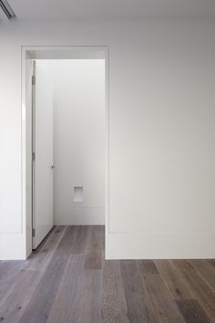 B.E Architecture reduced flush skirting and door detail used in period renovations to evoke the style of the older home in a new way