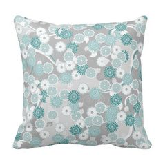 A pretty floral pattern with daisy style vector flowers in shades of teal and aqua blue green and white scattered randomly against a pale grey background / On Zazzle.com ~$32