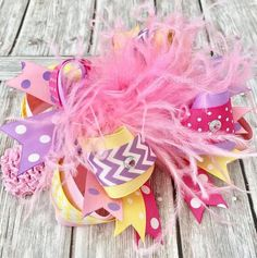 Express her playful side with this Pastel #Easter over the top hair bow from Beautiful Bows Boutique. Handmade in artistic detail, it features the perfect blend of color and... #new #girlshairbows #bighairbows #overthetopbows #tutudresses #babyrompers #birthday #easter #feathers #pink #purple #rhinestones ➡️ http://jto.li/8Svnb