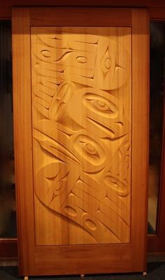 Red Cedar door entitled Sky Dancers: an eagle and raven design. Carved by Gordon Dick.    Northwest coast art and First Nations Art at Ahtsik Native Art Gallery.