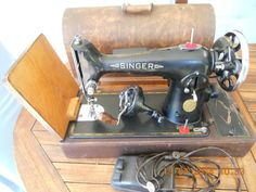 Singer 201K with both motor and handcrank; in a case.