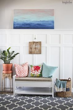 This entry is so beautiful and costal and beachy!  I love love all the colors, coral and aqua  Those pillows!