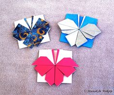 https://flic.kr/p/e5CNEW   Kusumita Derivatives - Butterflies. Meenakshi Mukerji   Each from single uncut square. Original model: www.flickr.com/photos/mmukhopadhyay/8519690046/ Diagrams in Wondrous One Sheet Origami now available from CreateSpace (www.createspace.com/4452070), Amazon US: www.amazon.com/dp/1492785288?tag=meensmodumani-20 Amazon UK: www.amazon.co.uk/dp/1492785288/ Amazon DE: www.amazon.de/dp/1492785288/ Preview in www.origamee.net/book5/index.html