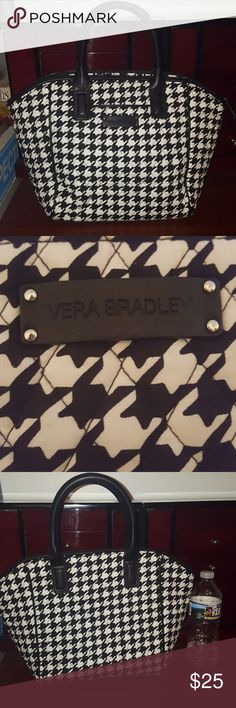Vera Bradley Houndstooth Bag The Superfund houndstooth Vera Bradley bag is in awesome condition it has been gently used with no signs of wear and stored in a pet free and smoke-free home it has a small pocket on the front with a zippered pocket inside and two open pockets on the opposite side I believe it is cotton I showed pictures up against a water bottle to show size and a picture of me holding it on my arms. Hope this helps people happy poshing and feel free to ask if you have any…
