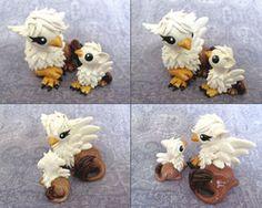Mama and Baby Gryphon by *DragonsAndBeasties on deviantART