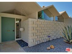 Palm Springs Textural Wall - Green Mid Century Modern Doors - Midcentury atomic ranch house Sliding Doors. Vtg 1950s/1960s  Front Entry Door: distinctive, modern entryway designs feature signature, iconic details with a vintage flair to nourish the nostalgic. Front Doors, Garage Doors, Concrete Walls, Patios. Popular door designs, door knobs and door colors from the 1950's, 1960's—and inspiration for today. #Eichler