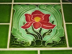 Art Nouveau Fireplace Hearth Tile of a Camelia    This beautiful Art Nouveau camelia features in a fireplace surround in a drawing room. The fireplace surround dates circa 1910.
