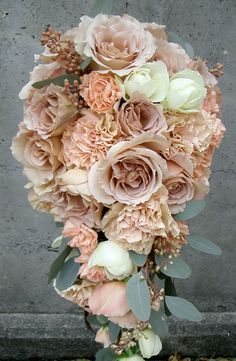 Autumn (October) - roses - I like the Cascading Bouquet. Featuring Nude/Beige/Blush Roses & Pastel Peach/Peach Carnations With White Roses & Seeded Eucalyptus~~ Carnation Bouquet, Hand Bouquet, Flower Bouquet Wedding, Floral Wedding, Fall Wedding, Carnations, Romantic Wedding Colors, Cascade Bouquet, Blush Roses