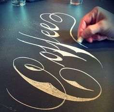Calligraphy on the bar top.