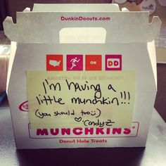 My baby announcement at work was a huge hit! Love this idea with cute dunkin donuts munchkins!!!!