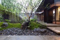 Atelier Deshaus creates glass and steel tea house for Shanghai garden