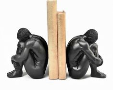 Quirky statues, bookends and trendy home decor. by hodihomedecor