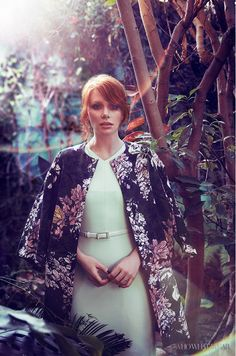Bryce Dallas Howard wears an MSGM floral coat, and belted Jason Wu dress