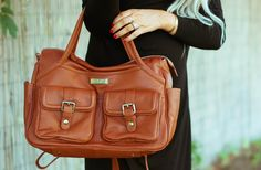 "Cara Loren. Designer Diaper Bag = Rave reviews!!! ""My favorite part of the diaper bag is how many different ways you can carry it (especially the backpack option)"" Lily-Jade created luxury bags that work as hard as you do. With over 14 pockets they are the perfect gift for the organized woman."