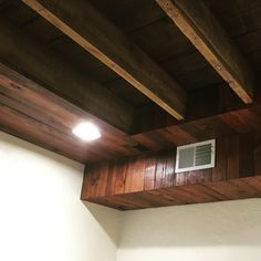 Hide duct work and ceiling wires in basement with something a bit more inspiring and inviting. Refaced reclaimed wood stained with Red Chestnut 232 (mineax)