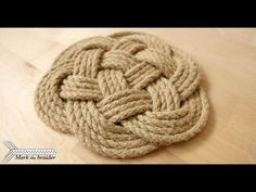 In this short tutorial I demonstrate how to make a round rope mat. This is a 7 bight 3 part turk's head. As you will see it is very simple and fast to tie. Hot Pads, Rope Rug, Rope Knots, Macrame Knots, Nautical Knots, Paracord Projects, Macrame Projects, Rope Crafts, Rope Basket