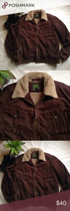 Men's Lined Corduroy Coat by Timberland!!🌲❄️ Men's lined Corduroy coat by Timberland!! Great faux Sherpa lining....perfect for winter! Brown Corduroy exterior with lots of pockets. She'll is 100% cotton, lining is 100% polyester....fully machine washable!! Timberland quality....Great used condition🌲❄️ Timberland Jackets & Coats Bomber & Varsity