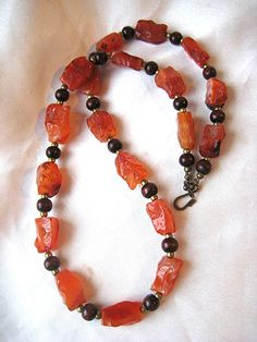 Chunky, boho carnelian necklace with wood, & brass beads. Red orange autumn colored luminous stones. Hand-knapped, tribal, primitive texture by WildThingsAdornments