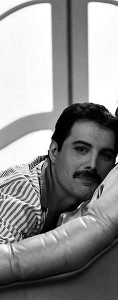 "A cropped photo of Freddie looking adorable on set of the ""I was Born to Love You"" video"
