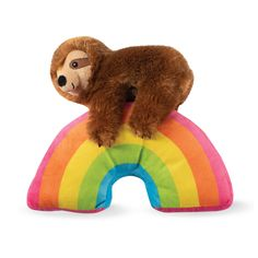 Somewhere over the rainbow is a precious plush sloth! Pet Shop by Fringe Studio's Ziggy Over the Rainbow Dog Toy is a stuffed vibrant rainbow with a fluffy, happy sloth on top who just doesn't want to let go! Even though this one-of-a-kind plush is undeniably adorable, it's what's on the inside that really counts. Your canine companion will love discovering the extra-loud internal squeaker and crinkle paper that are sure to tempt her to play an exciting game of fetch or catch. It makes the… Cute Dog Toys, Pet Toys, Cute Dogs, Rainbow Dog, Dog Christmas Gifts, Novelty Toys, Buy Pets, Dog Gifts, Dog Care