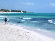 Walking on the white sand of Playa del Carmen, Mexico....
