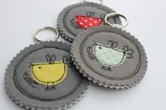 This fabric Birdy keyring has been handmade using pretty cottons, appliqued onto… Freehand Machine Embroidery, Free Motion Embroidery, Free Machine Embroidery, Embroidery Applique, Fabric Birds, Fabric Scraps, Wool Fabric, Scrap Fabric, Diy Keychain