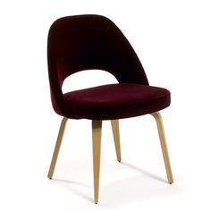 Legs come in different finishes (WALNUT) More fabric choices, but I do like the dark red color. Would go great with the black marble top.