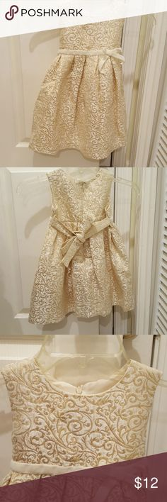NWOT Beautiful 4T Dress! Gold & Cream This NWOT dress is so pretty, and it's neutral but sparkly, so it can be used for any occasion! The gold pattern really glimmers! Has a bow in front and a bow in back! George Dresses