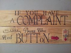If you have a complaint.............reclaimed wood, sanded, unfinished, stenciled with a mouse-trap with red wooden button.  $20.