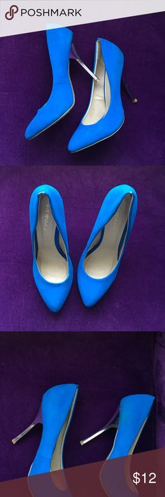 Blue heels size 8.5 Lightly wore size 8.5 blue heels with silver heel. Shoes Heels