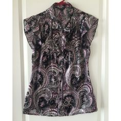 Paisley dress shirt 🔹Maurices 🔹medium 🔹pink and black paisley pattern  🔹ruffle cap sleeves 🔹ruffles around top buttons 🔹looks great when worn under a vest 🔹pattern alternates between solid and semi sheer stripes 🔹item is free from rips, tears and stains 🔹no swaps or trades 🔹reasonable offers accepted Maurices Tops