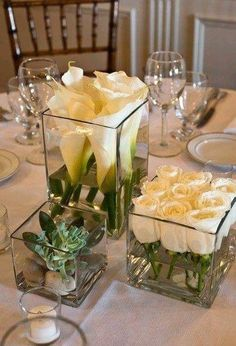Roses and calla lily in glass containers make a beautiful centerpiece